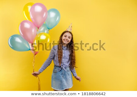 Little girl with colorful air balls element stock photo © studioworkstock