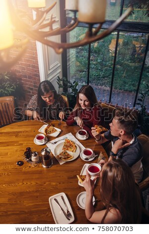 Four teenagers in a cafe Stock photo © IS2