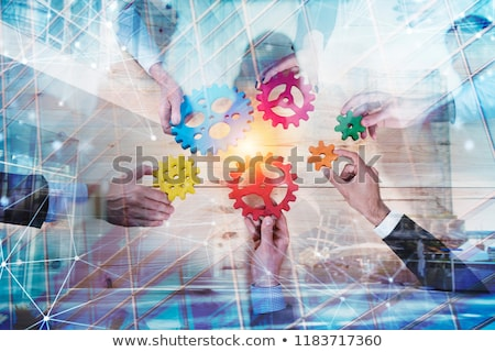 Business team with gears system. Teamwork, partnership and integration concept with network effect.  Stock photo © alphaspirit
