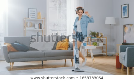 woman or housewife with vacuum cleaner at home Stock photo © dolgachov