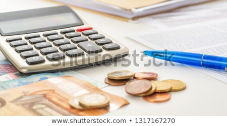 Calculator with euro bills and coins on documents Stock photo © Zerbor
