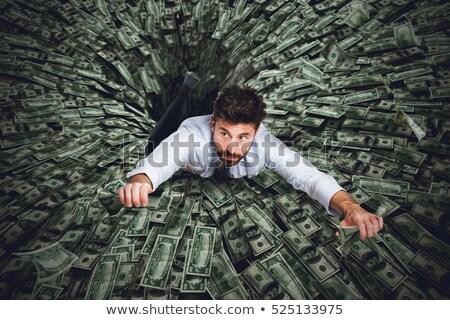 Businessman swallowed by black hole of money Stock photo © alphaspirit