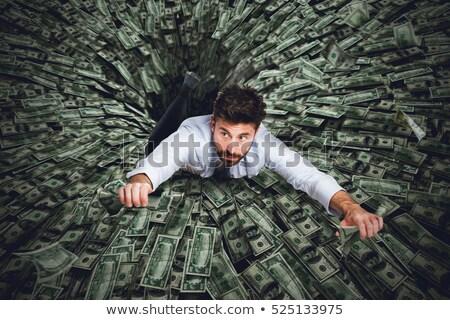 ストックフォト: Businessman Swallowed By Black Hole Of Money