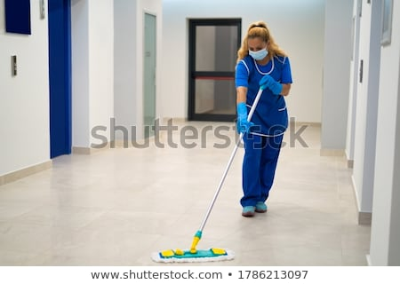 Young Janitor Cleaning Floor Stock photo © AndreyPopov