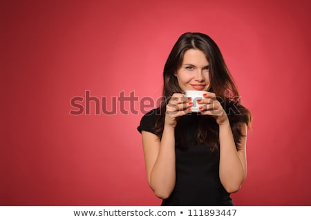 Stock photo: woman in red holding cup and smiles