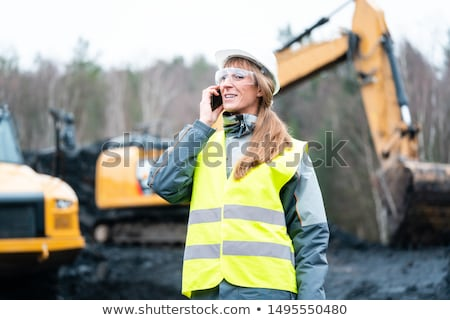 worker woman in open cast mining using phone stock photo © kzenon