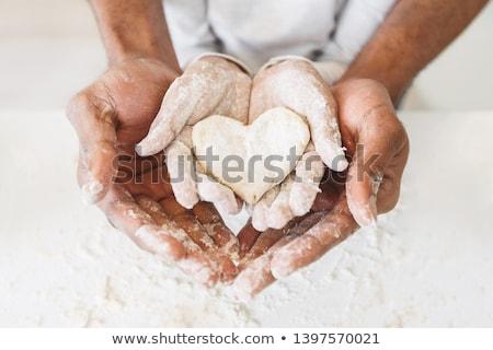 Male baker baking christmas bread stock photo © colematt