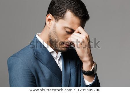Szomorú fáradt üzletember fejfájás pózol izolált Stock fotó © deandrobot