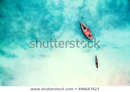palmera · barcos · puesta · de · sol · isla · tropical · mar · palma - foto stock © denbelitsky