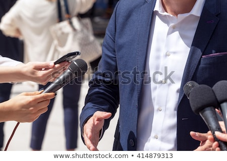 News Reporter Asking Question To Businessman Stock photo © AndreyPopov
