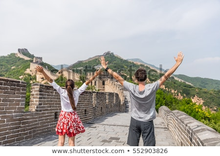 Happy cheerful joyful tourist man at Great Wall of China having  Stock photo © galitskaya
