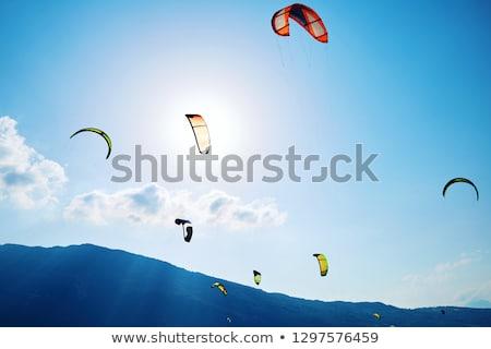 Színes siklórepülés képződmény fölött mikulás tó Stock fotó © frimufilms