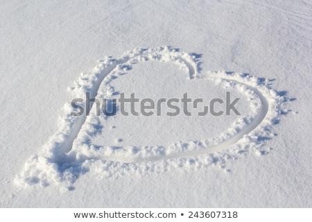 heart shape drawn on white snow love symbol stock photo © caimacanul