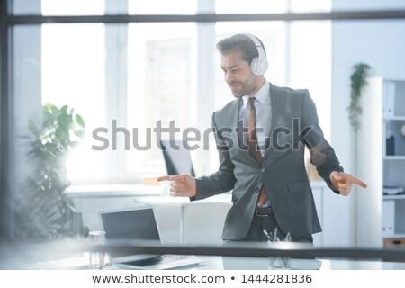 Feliz jovem dinâmico empresário fones de ouvido dança Foto stock © pressmaster