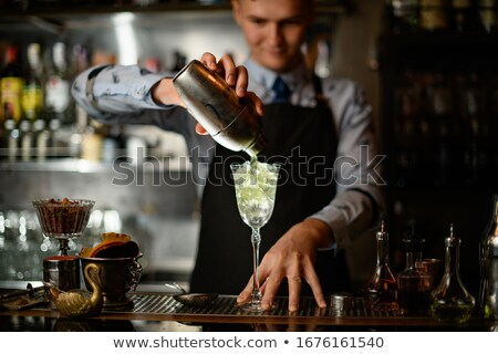 young bartender pouring drinks stock photo © jossdiim