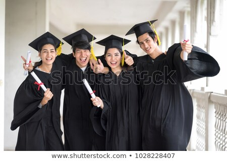 Graduation day, Images of hand holding a certificate and Caps or Stock photo © Freedomz