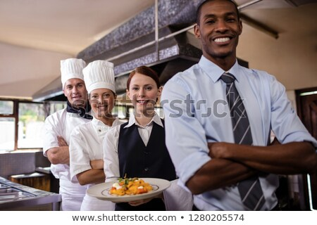 Group of hotel staffs standing with armas crossed in kitchen at hotel Stock photo © wavebreak_media