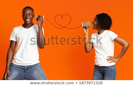 Playful young couple with word happiness. Stock photo © lichtmeister