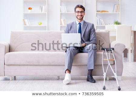 freelancer with foot injury working from home stock photo © elnur