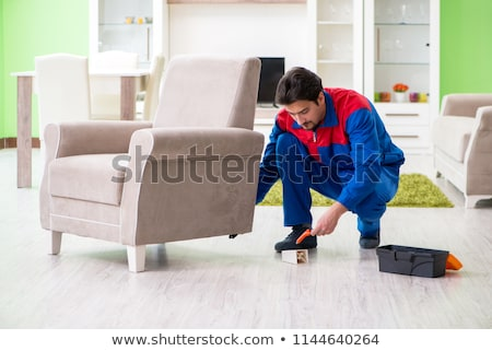 Stock photo: Repair contractor repairing broken furniture at home