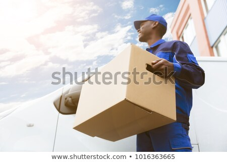 Happy Male Movers Holding Cardboard Boxes Stock photo © AndreyPopov