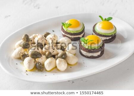 Appetizer with canape, mozzarella and capers Stock photo © Alex9500