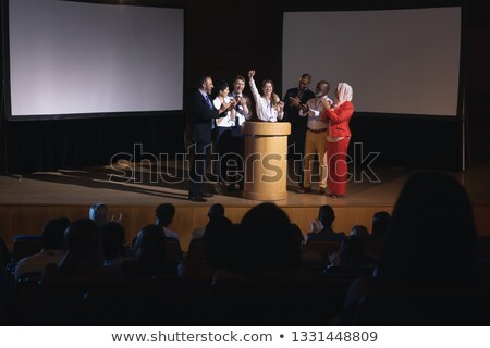 Front view of happy mixed race businessman standing at the stage of the auditorium with colleagues i Stock photo © wavebreak_media