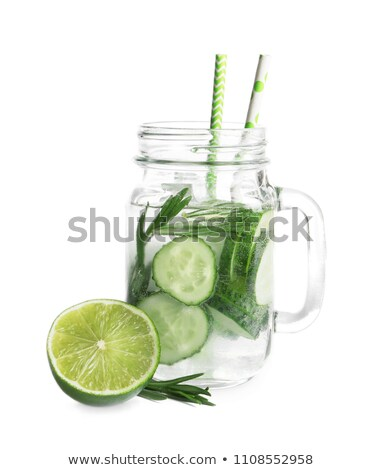 Fresh cold cucumber water with ice cubes and cucumber slices isolated on white. Healthy and refreshi Stock photo © DenisMArt