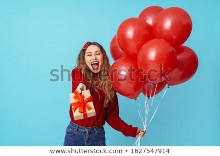 Kép elragadtatott szőke nő tart ajándék doboz léggömbök Stock fotó © deandrobot