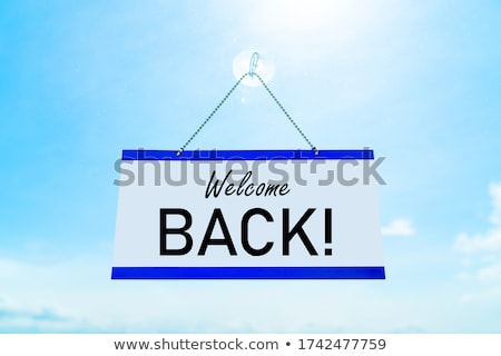 COVID-19 WELCOME BACK! Open for business sign hanging on storefront icon for stores reopening after  Stock photo © Maridav