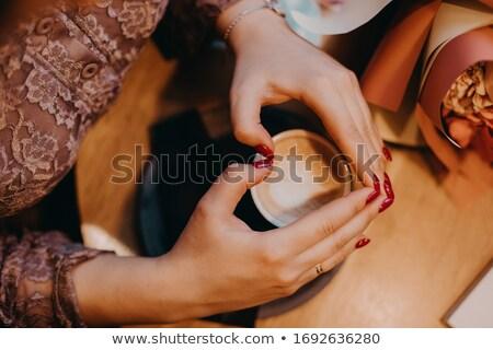 Heart shape, hands with spa mug on Stock photo © zurijeta