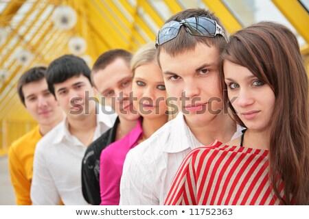 csoport · fiatal · barátok · áll · gyaloghíd · épület - stock fotó © Paha_L