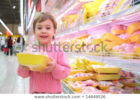 Stock photo: girl holds in hands packing with  hen in shop