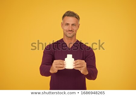 Man holding perfume aftershave Stock photo © lovleah