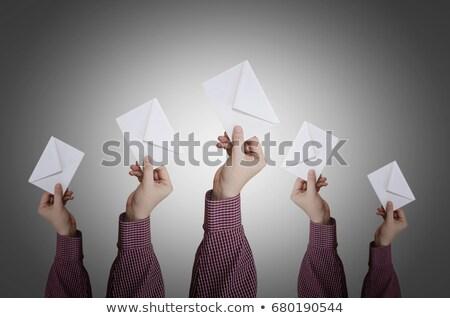 surpreendido · caucasiano · homem · de · negócios · envelope - foto stock © Qingwa