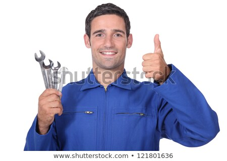 head and shoulders portrait of plumber holding wrenches all smiles Stock photo © photography33