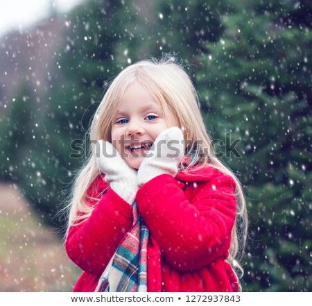 Cute little girl wearing a red coat Stock photo © photography33