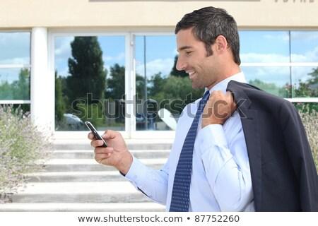 üzletember · küldés · szöveges · üzenet · vállalati · fickó · sms · chat - stock fotó © photography33