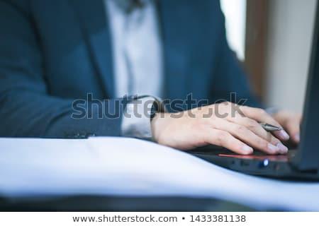Empresário trabalhando documentos retrato jovem negócio Foto stock © pablocalvog