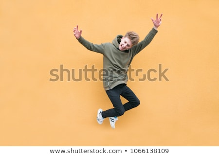 happy teenager jumping with excitement stock photo © stockyimages