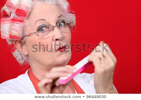 Elderly woman filing her nails Stock photo © photography33