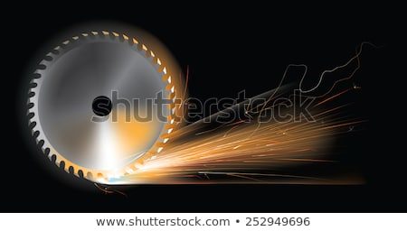 Spinning disk of circular saw with sparks stock photo © Olesha