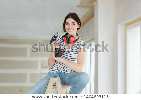 Woman on a stepladder with a powerdrill Stock photo © photography33
