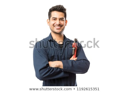 portrait of handsome plumber with adjustable wrench and pipe Stock photo © photography33