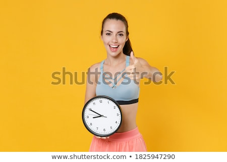 young fitness woman showing thumbs up stock photo © rob_stark