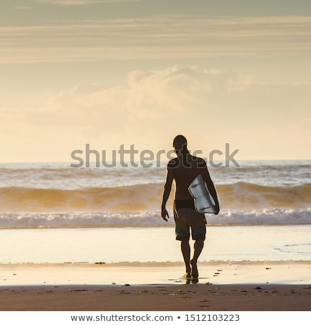 Surfista caminhada praia ondas pôr do sol Portugal Foto stock © homydesign