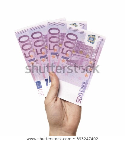 male hand holding four 500 euro notes isolated stock photo © shutswis