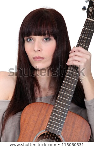 Busker posing with her guitar Stock photo © photography33