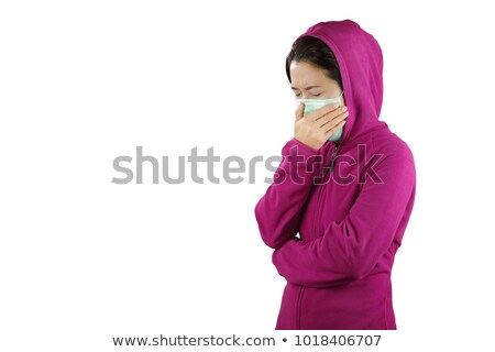 A femal patient blows her nose against white background Stock photo © wavebreak_media