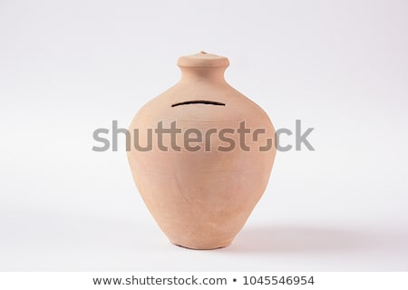 pots of clay with coins Stock photo © marinini